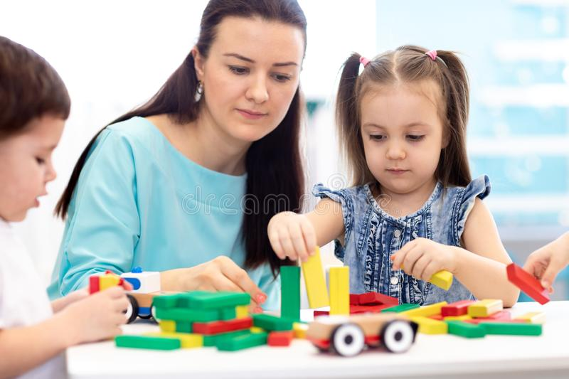 Little children building block toys at home or daycare. Kids playing with color blocks. Educational toys for preschool royalty free stock image