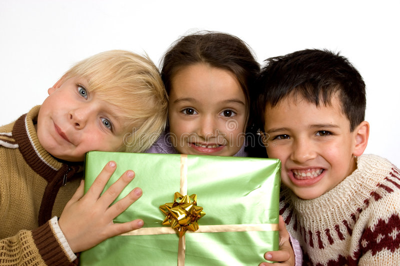 Little children with christmas gifts stock photo