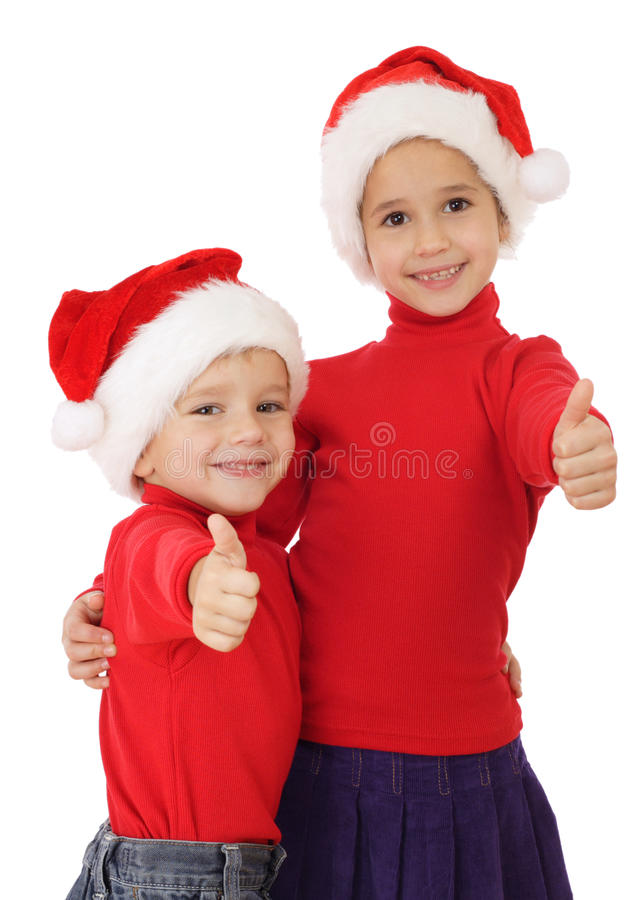 Little children in Christmas hats and ok sign royalty free stock image