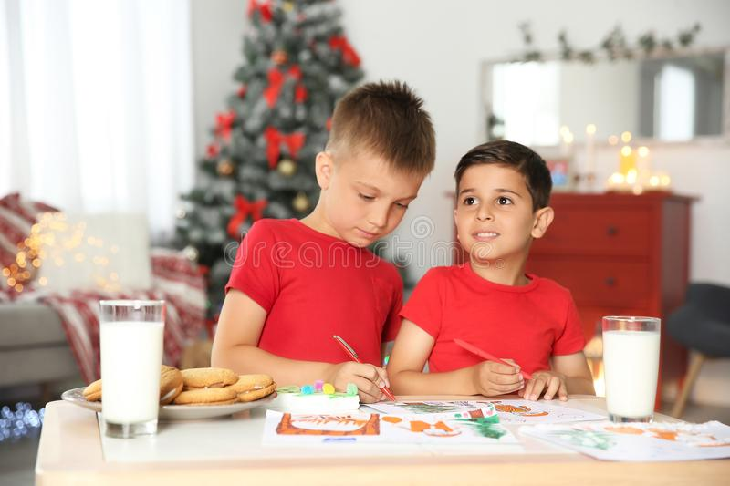 Little children drawing picture at home. Christmas celebration stock images