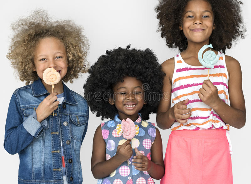 Little Children Eating Lollipop Candy Smile royalty free stock photos