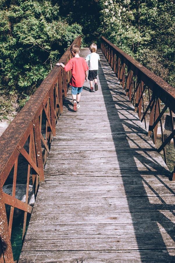 Little children friends on the bridge sensory connections stock images
