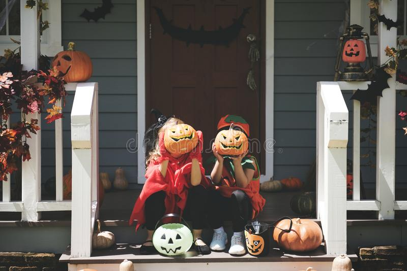 Little children in Halloween costumes stock photo