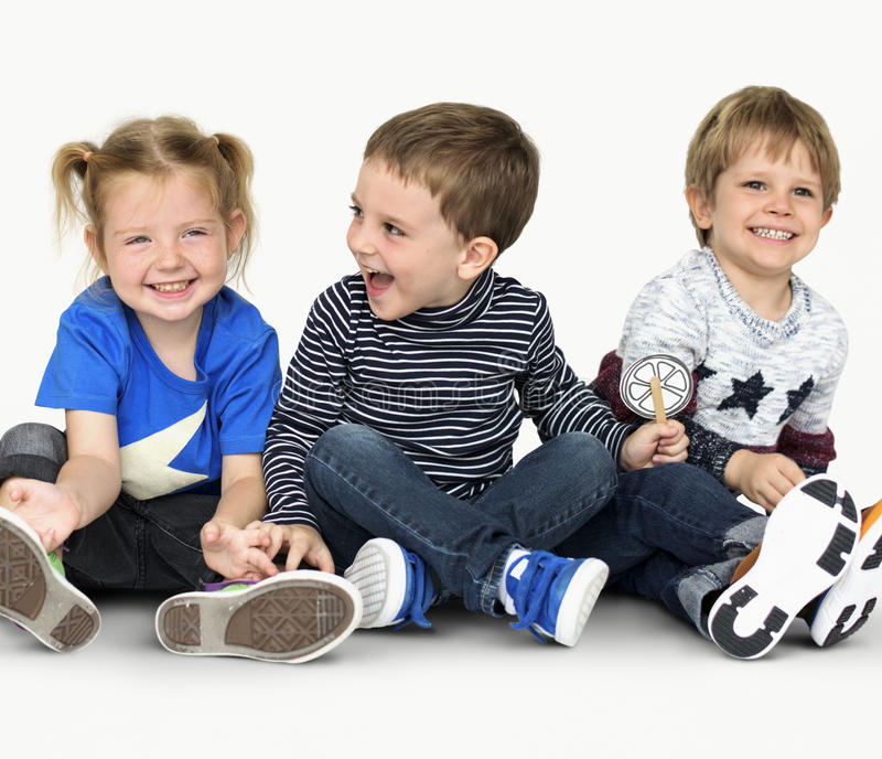 Little Children Holding Down Happy Cheerful royalty free stock image