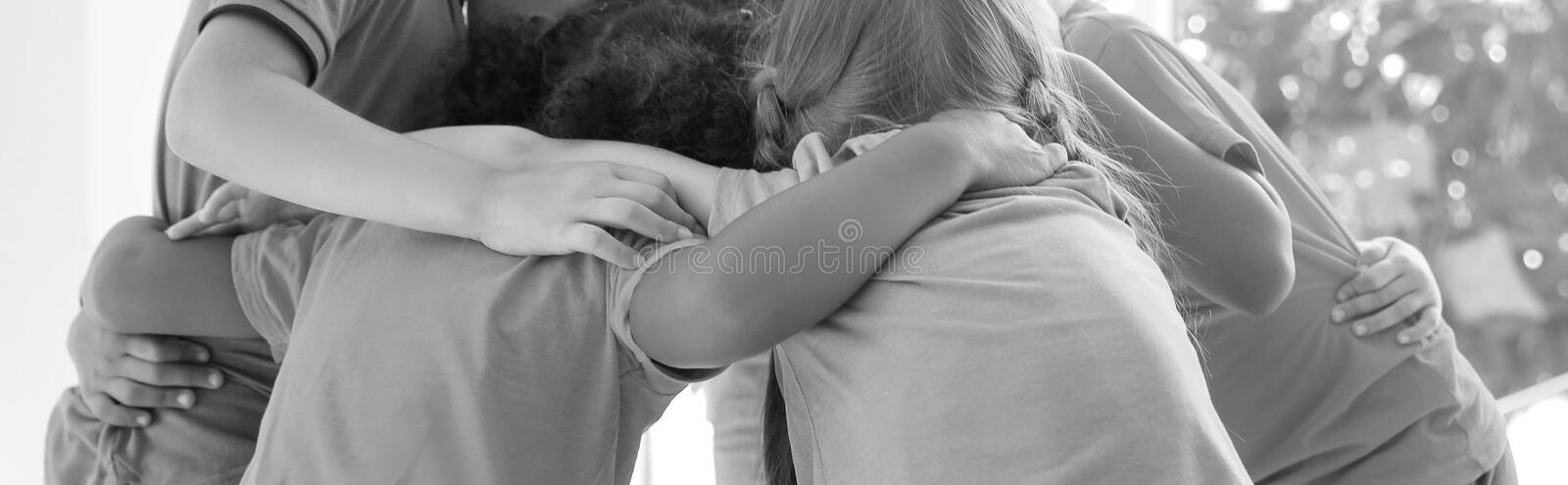 Little children making circle with hands around each other indoors. royalty free stock photo