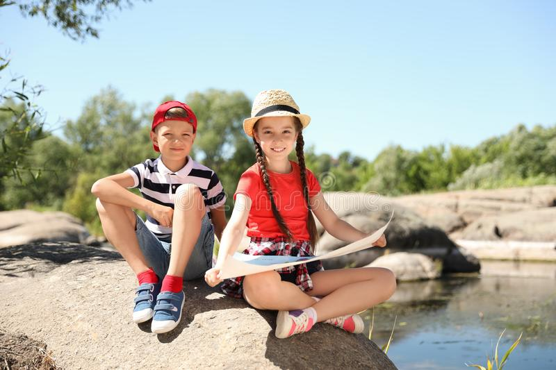 Little children with map outdoors royalty free stock photo