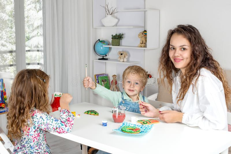 Little children with a nanny or with a young mother or with a te stock photos