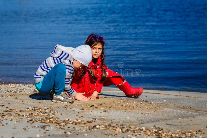 Little children play by the sea royalty free stock photography