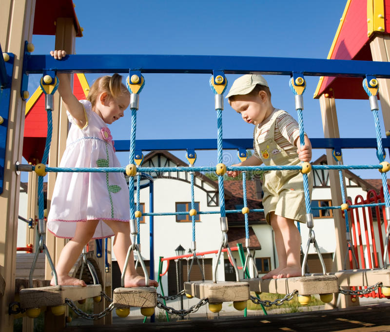 Little children on playground royalty free stock photos