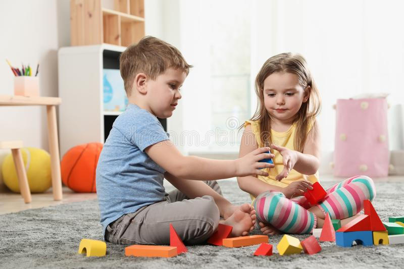 Little children playing with colorful blocks royalty free stock photo