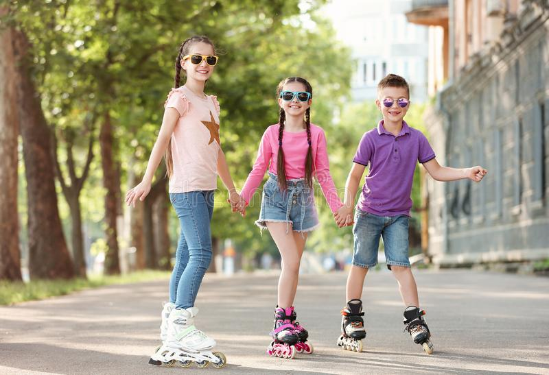 Little children roller skating stock images