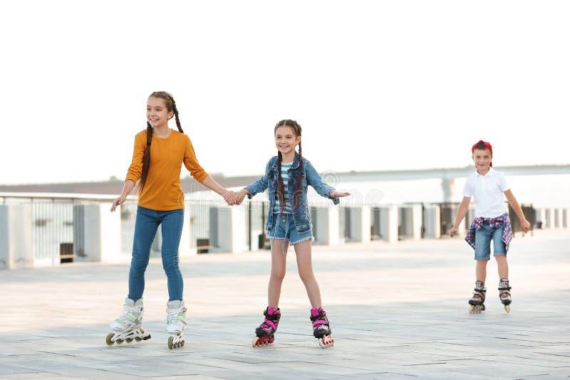 Little children roller skating royalty free stock photos