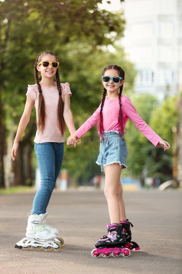 Little children roller skating stock photo