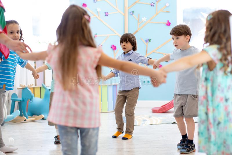 Little children roundelay on lesson stock photography
