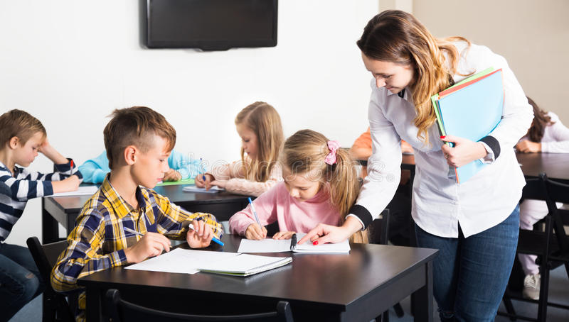 Little children with teacher in classroom royalty free stock photos