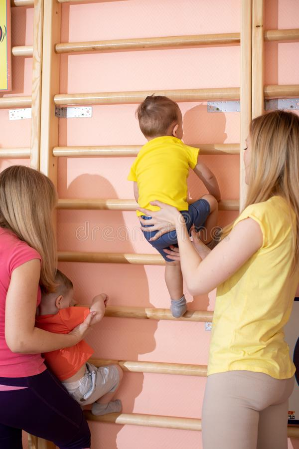 Little children toddlers climbing up the gymnastic stairs. Healthy lifestyle from childhood royalty free stock photography