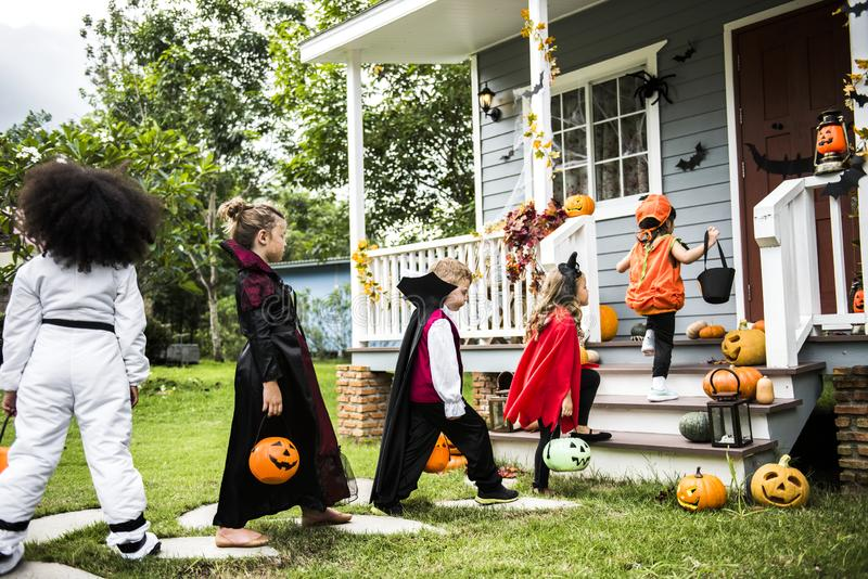 Little children trick or treating stock image