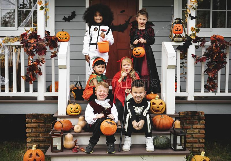 Little children trick or treating stock images