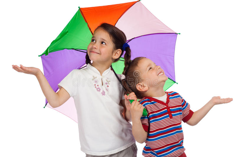 Little children with umbrella, checking for rain. Two little children holding colored umbrella and checking for rain stock photography
