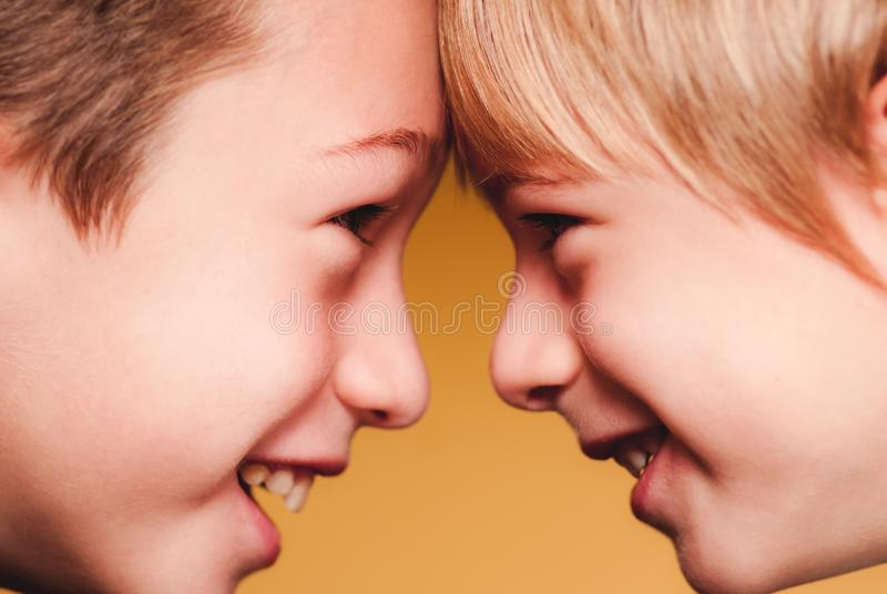 Little childrens friends face to face sensory connections stock image