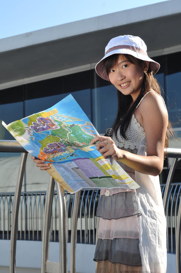 Free Little Chinese Asian Tourist Girl With Map 2 Stock Photos - 16172053