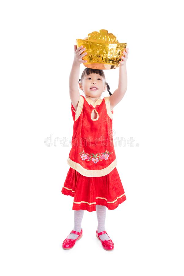 Little chinese girl smiling while holding money bank royalty free stock photos