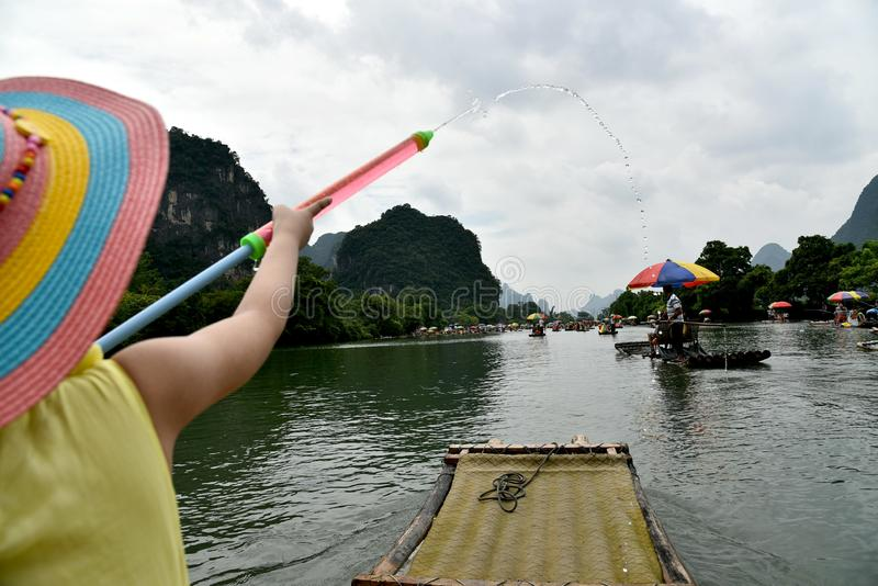 a little chinese girl on yulong river, yangsuo county ,chiina stock photography