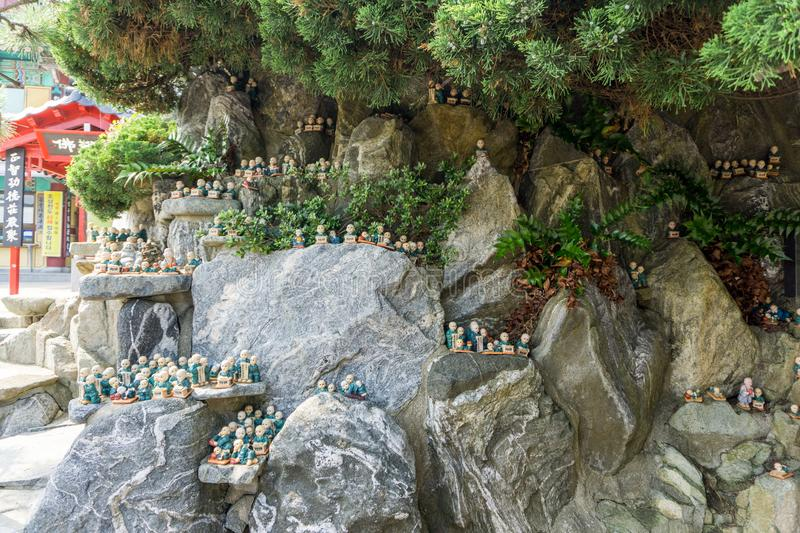 Little chinese priest stone sculptures in the garden of Haedong Yonggungsa Temple. In Busan, South Korea royalty free stock images