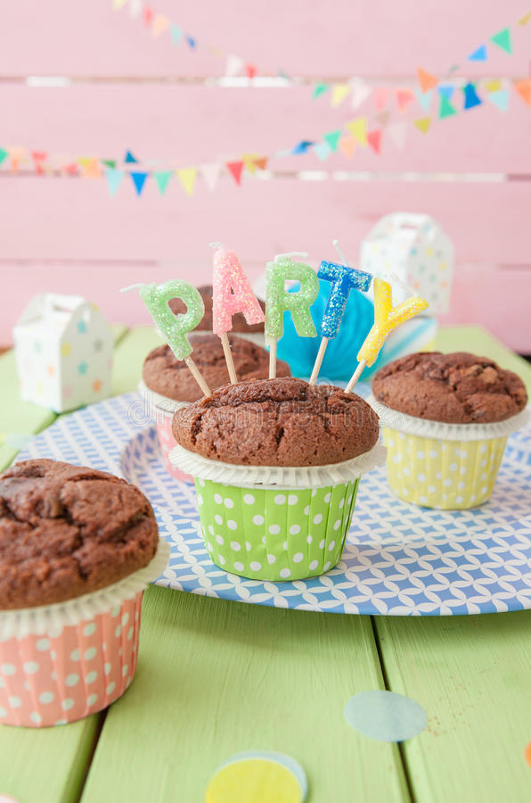 Little chocolate muffins. In colorful polka dots cups royalty free stock photos