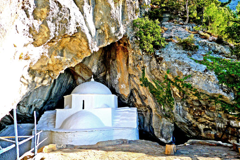 Panagia Makrini `Distant Virgin Mary` church, hidden in a cave of Kerkis mountain, Samos island, Greece. A typical Greek church set in the mountains in the royalty free stock photo