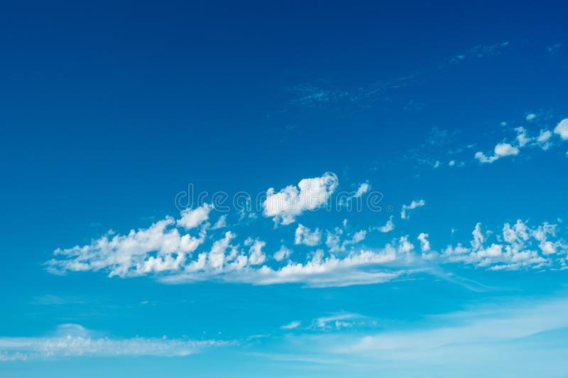 Little clouds blue sky stock photography