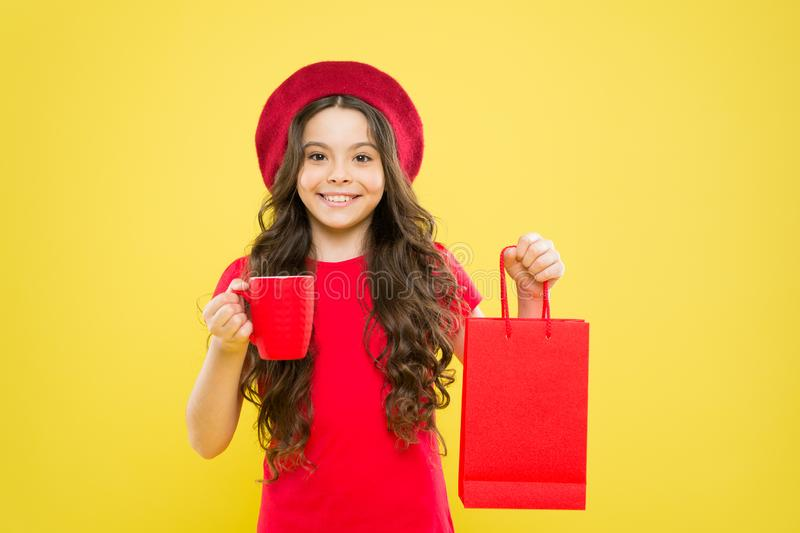 Little coffee break and keep buying. Shopping and purchase. Black friday. Shopping day. Child hold package. Girl with royalty free stock photos
