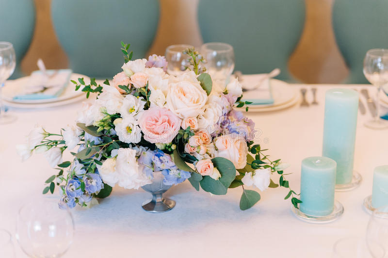 A little composition of petals and candles on table royalty free stock photos