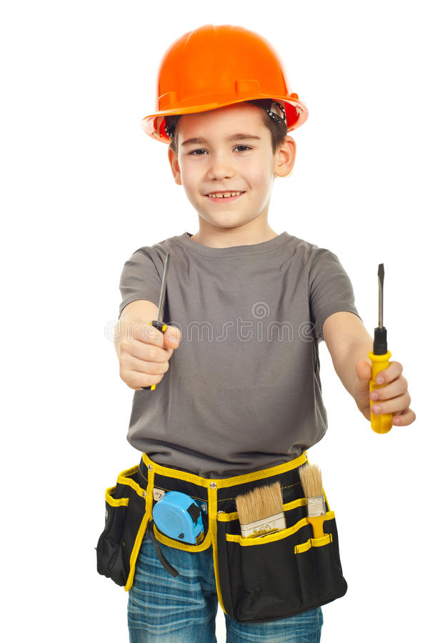 Little constructor boy giving screwdrivers royalty free stock image