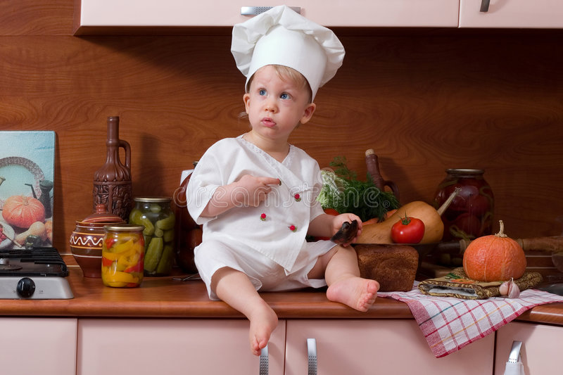 Download Little cook stock photo. Image of bottle, expressions - 1688278