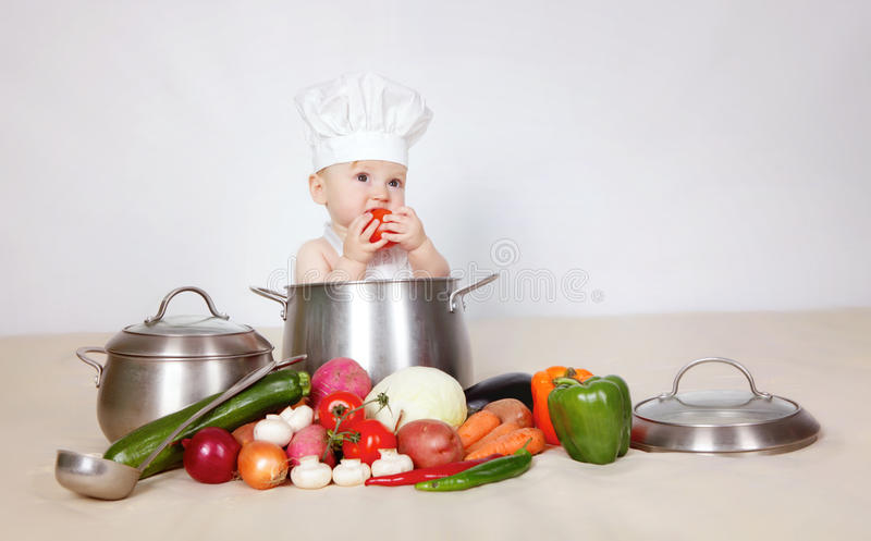 Little cook. Little baby cook in studio royalty free stock photos