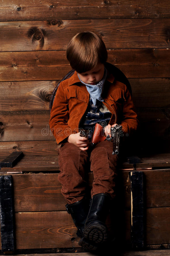 Download Little cowboy stock image. Image of cowboy, looking, boots - 27342779