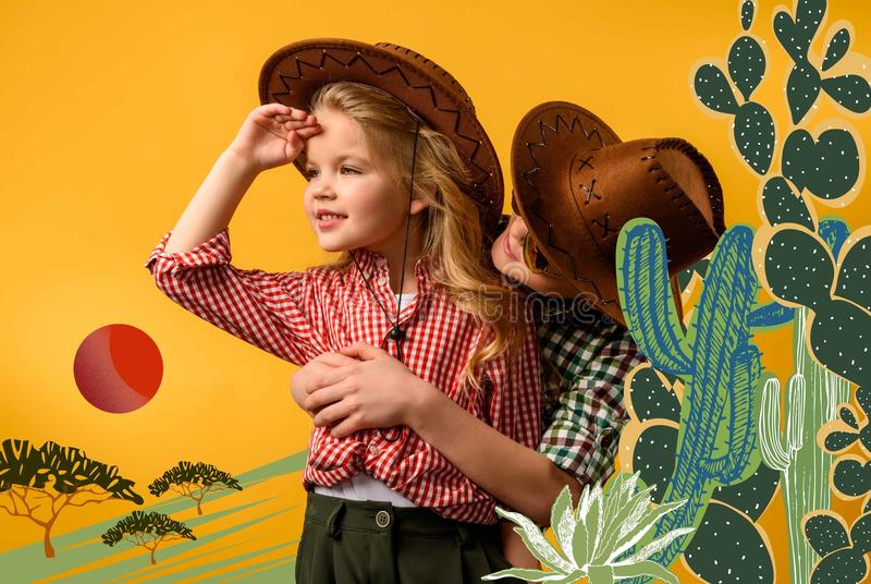 little cowboy embracing stylish cowgirl, stock photography