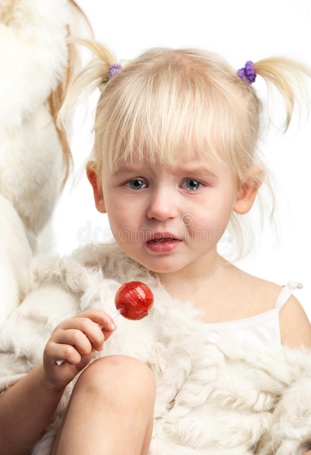 Free Little Crying Girl With A Candy Over White Royalty Free Stock Images - 38117529