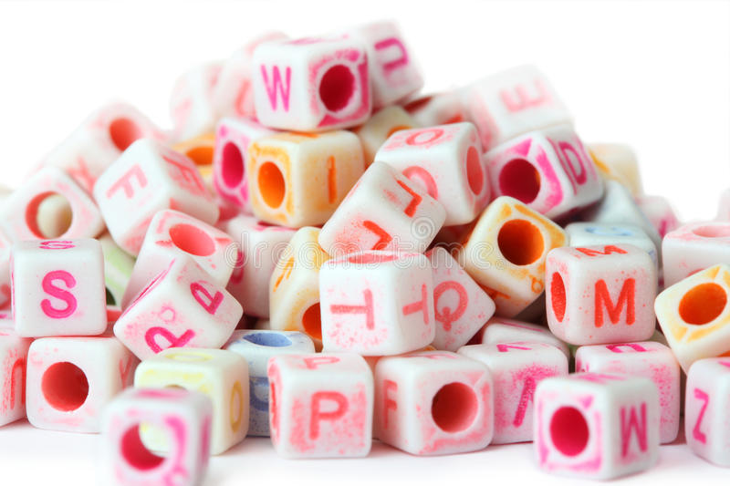 Little cube beads with letters, isolated stock photos