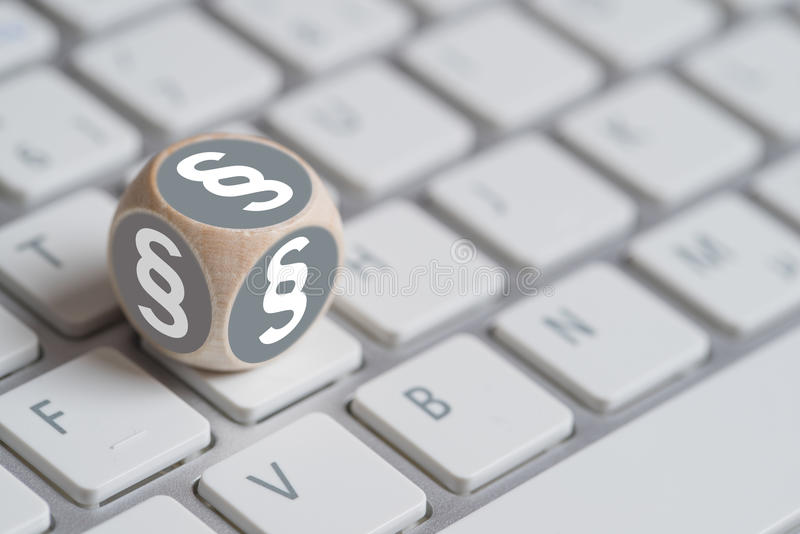 Little cube with a paragraph symbol. On a computer keyboard royalty free stock photos