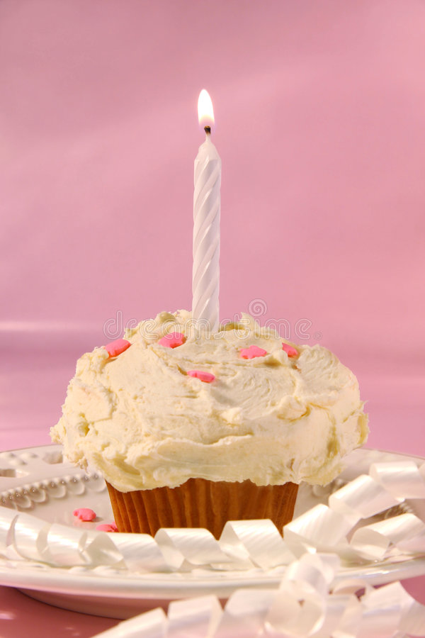 Little cupcake with candle royalty free stock image