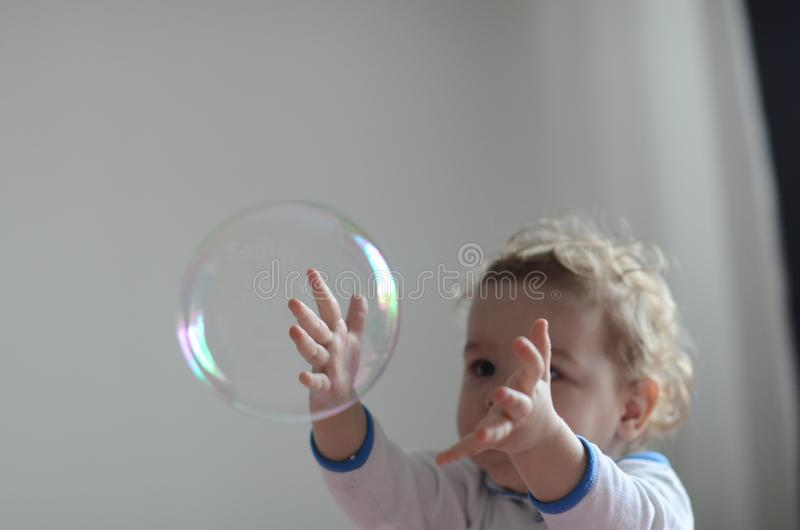 Girl playing with soap bubbles royalty free stock photos