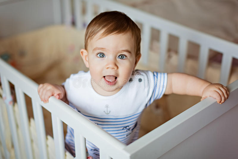 Little cute adorable little blond boy in a striped bodykit is in royalty free stock photography