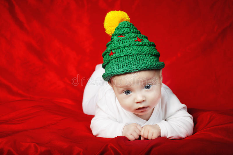 Download Little Cute Baby With Christmas Tree Hat Stock Photo - Image: 34385234