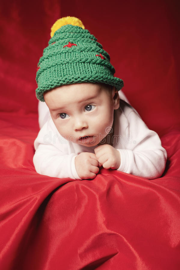 Download Little Cute Baby With Christmas Tree Hat Stock Photo - Image: 34385284