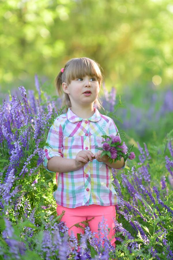 Little cute baby girl stand and smile, laugh, play, grimaces royalty free stock photos