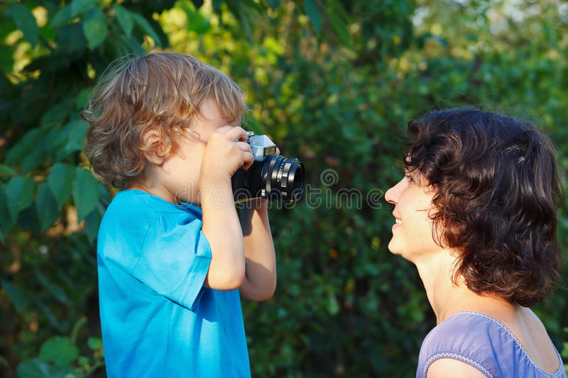 Little Cute Blond Boy With A Camera Shoots Mother Stock Images