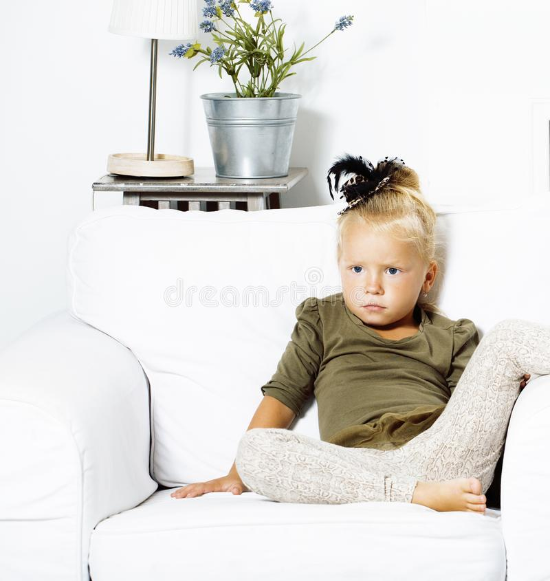Little cute blond girl at home interior happy smiling close up, lifestyle people concept royalty free stock images