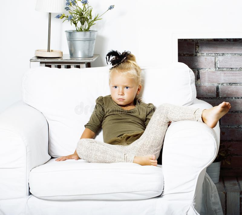 Little cute blond girl at home interior happy smiling close up, lifestyle people concept royalty free stock photography